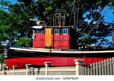 Mystic, Connecticut: - July 11, 2014:  The Kingston II tugboat stands at the entrance to Mystic Seaport Museum  *
