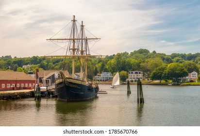 Mystic, Connecticut - June 20, 2020: Mystic Seaport, outdoor recreated 19th century village and educational maritime museum in Mystic, Connecticut. Wooden vessel docks.