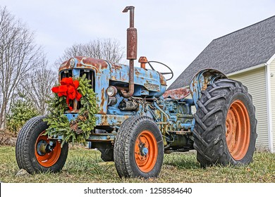 Mystic, CT/USA- December 14, 2018: A horizontal HIGH DEFINITION image of a vintage farm tractor decked out for the holidays.