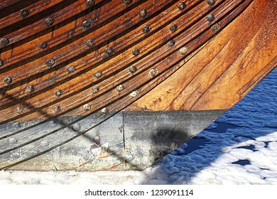 Mystic, CT/USA- November 22, 2018: A horizontal image of the waterline of the vintage Viking ship, the Draken Harald Hårfagre, at Mystic Seaport.