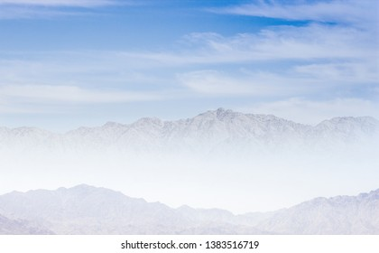 mystic dramatic mountain in morning fog picturesque scenery landscape in white and blue colors