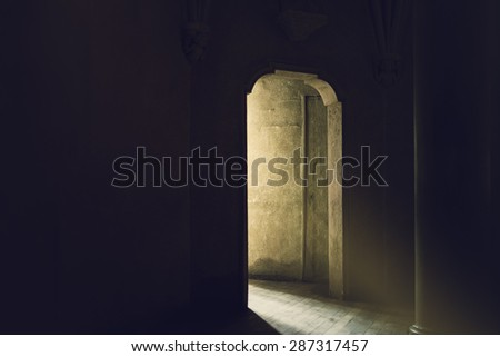 Mystic Gothic Door with Sunlight Entering Dark Room, Exit to Light, Hope and New Beginning Concept, Vintage Retro Tone Effect