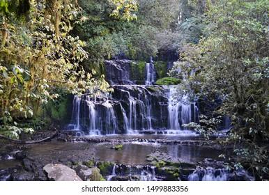 Mystic hidden waterfall in autumn - Shutterstock ID 1499883356