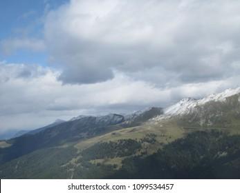 Mystic menacing clouds hanging over Rhône Valley viewed from the top of Dent de Nendaz summit in Valais / Wallis - Switzerland