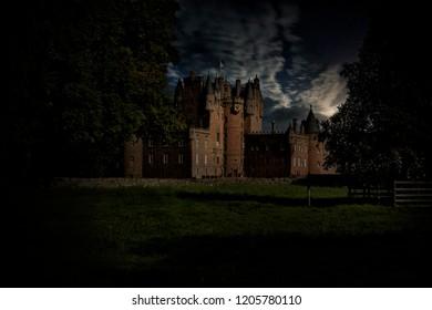 Mystic moonlight falls on a castle in Scotland