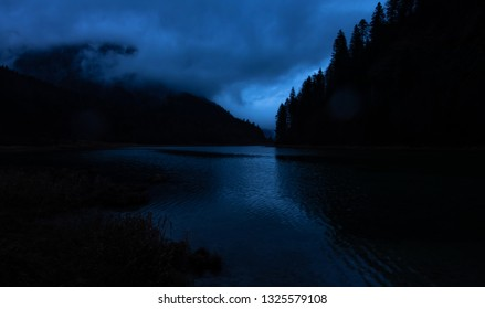 mystic mountain lake in moonlight, hope in the darkness