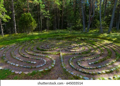 Mystic oriental stone labyrinth in green forest, aestetic symbol
