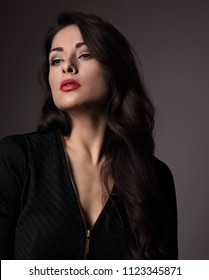 Mystic sexy makeup woman with red bright lipstick looking sexy on dark shadow background. Closeup portrait