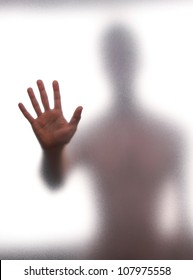 Mystic silhouette of man against the transparent wall