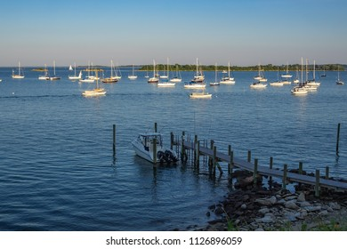 Mystic, USA - July 1st 2018: Boats at the coast of Connecticut during sunset.