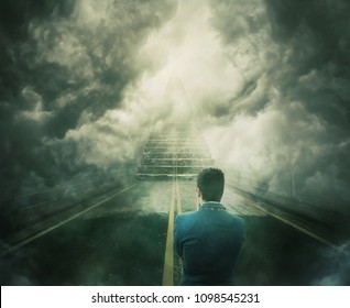 Mystic view as a man stand on the road transforming into a stairway going up to unknown heaven. Difficult decision, concept of the important choice. Opportunity staircase, way to failure or success.
