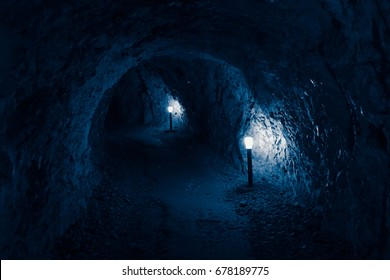 Mystic view of the the underground of cave pathway. Bulgaria, Devil throat cave, scary background.