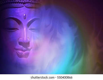 Mystical Buddha Background - ethereal colored gaseous vapours rising up with a partial Buddha head emerging from the darkness on left side and copy space on right