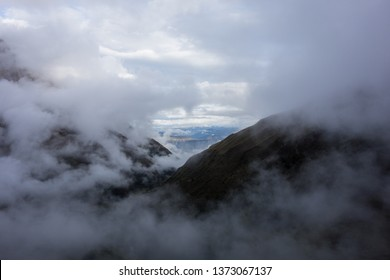 Mystical clouds opening a small window at the Salkantay Trek to Machu Pichu, Peru