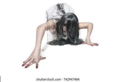 Mystical ghost woman in white long shirt crawl on white background