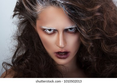 mystical girl and mysterious girl with makeup in the style of art visage with bloody lips looks