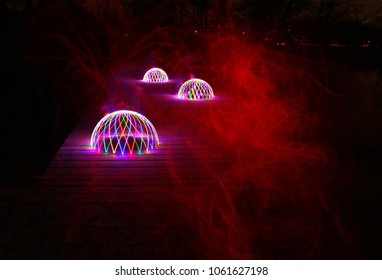 Mystical glowing domes with red mist