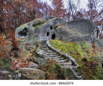 Mystical head over entrance to Cave monastery in the village Rozhirche near Lviv, Ukraine
