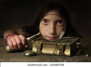 Mystical image of girl with magnifying glass