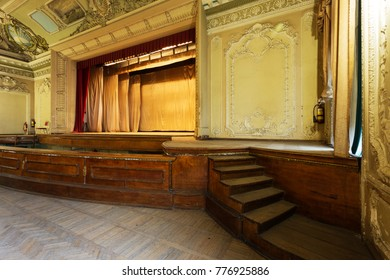 Mystical interior of old provincial Soviet theater of USSR. Stucco frescoes, nostalgic painting of walls and ceilings with fragments of revolutionary history USSR. Interior in luxurious Empire style