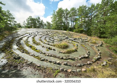 A mystical labyrinth made of small rocks in the island of Nauvo, Finland. It is said that the wives of sailors waited for their huspbands there, looking at the sea. Focus stacked