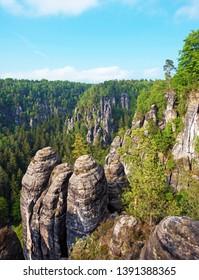 Mystical landscape with rocks near Rathen, Germany, Europe (Sachsische Schweiz)