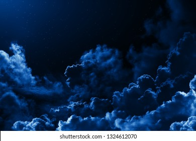 Mystical midnight sky with stars surrounded by dramatic clouds. Dark natural background with night starry cloudy sky. Moonlit clouds