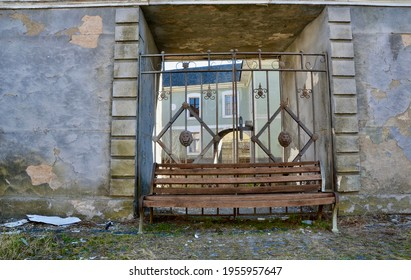 A mystical old wooden bench in an abandoned place. An unusual bench in an ordinary place. An old wooden bench.