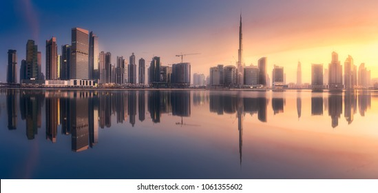 Mystical panoramic view of Dubai Business bay with purple sunrise, UAE