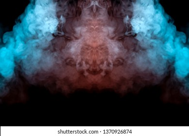 Mystical pattern of green, blue and pink colored smoke in the shape of a ghost's face with big eyes and an open mouth creating a feeling of fear on a black isolated background from a horror movie.
