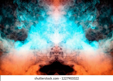 Mystical pattern of orange and blue colored smoke in the shape of a ghost's face with big eyes and an open mouth creating a feeling of fear on a black isolated background from a horror movie.
