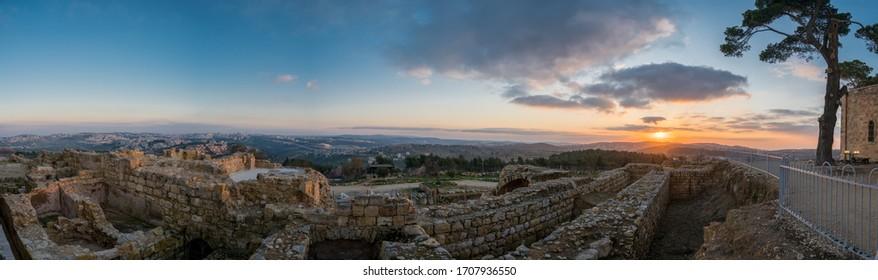 Mystical sunset over Jerusalem and the ruins of the Hellenistic city and the Crusader castle seen from the Tomb of prophet Samuel (Nebi Samwil/Kever Shmuel ha-Nevi), Jerusalem, Israel