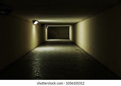 mystical theme of the tunnel, the long gloomy corridor into the unknown, the light at the end of the tunnel. Infinity, uncertainty, conceptual illustration of the insoluble problems of sociology