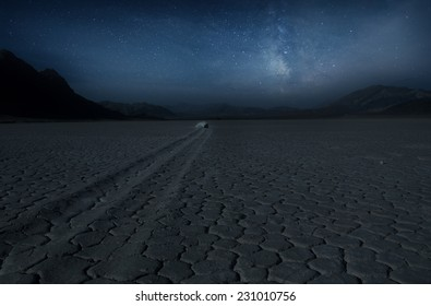 Mystique sailing rock  under night sky and milky way