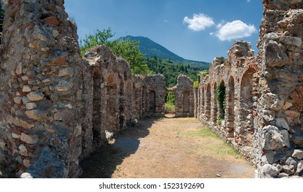 "MYSTRAS, PELOPONNESE, GREECE - JULY  28, 2019: Ruins besiode the Hagia Sophia church in the medieval, byzantine ""castletown"" of Mystras, close to Sparta town, Lakonia, Peloponnese."
