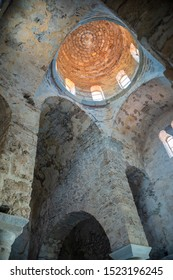 "MYSTRAS, PELOPONNESE, GREECE - JULY  28, 2019: Inside View of the Hagia Sophia church in the medieval, byzantine ""castletown"" of Mystras, close to Sparta town, Lakonia, Peloponnese."