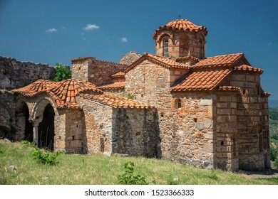 "MYSTRAS, PELOPONNESE, GREECE - JULY  28, 2019: Panagia Evangelistria church in the medieval, byzantine ""castletown"" of Mystras, close to Sparta town, Lakonia, Peloponnese."