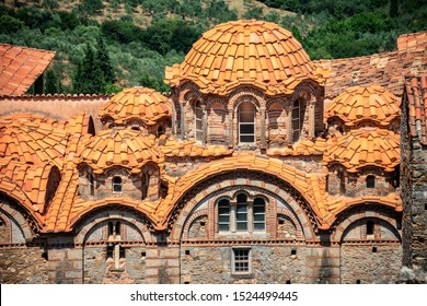"MYSTRAS, PELOPONNESE, GREECE - JULY  28, 2019: Impressions of the Moni Panagia Pantanassa Monastery in the medieval, byzantine ""castletown"" of Mystras, close to Sparta town, Lakonia, Peloponnese."