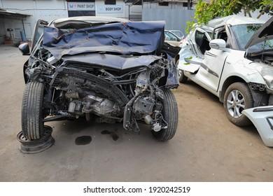 Mysuru,Karnataka,India-February 17 2021; A Close up view of Maruti Suzuki Car which is in damaged due to an Road accident in the Showroom in Mysuru,India.