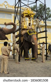 Mysuru,Karnataka/India-October 18 2020; Golden Howdah is being placed on the Royal Elephant with the help of a Mechanical Lift by the handlers for the Dussehra festival in Ambavilas Palace at Mysuru.