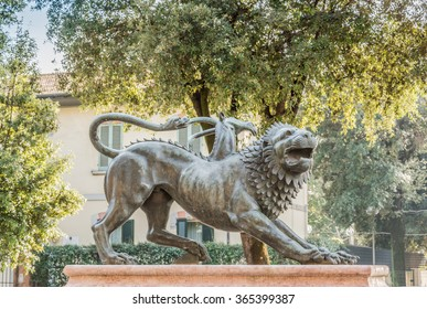 Mythological bronze monument representing the Etruscan city of Arezzo in Tuscany Italy. The monument is located at the entrance of the town in a fountain.