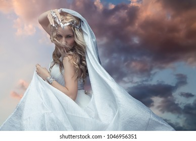Mythology, Greek goddess, blond woman with silver laurel wreath dressed in white silks in the wind. sunset in ancient greece