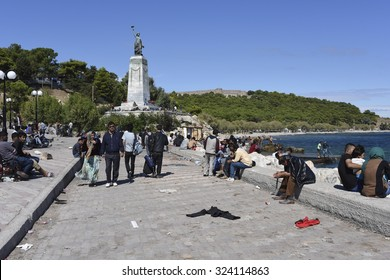 MYTILENE, GREECE - SEPTEMBER 30, 2015. Refugees wait in the harbour area of Mytilene, Lesvos, Greece before boarding boats for Athens. Lesvos has been a hot spot for refugees arriving from Turkey,