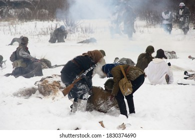 """Mytishchi district, village of Sholokhovo, Russia. December 8, 2018. A soldiers in an old military uniform at the Military-historical reconstruction """"Battle of Moscow. Counterattack"""""""