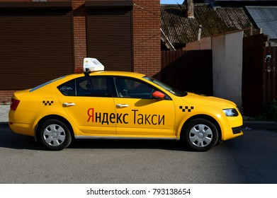 """MYTISHCHI, RUSSIA - AUGUST 12, 2017: Yellow car """"Yandex taxi"""" on the street in the city of Mytischi."""