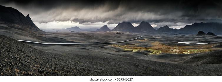 Myvatn, Iceland - Panorama of long road through vast stormy volcanic landscape