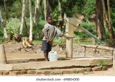 MZUZU, MALAWI - December 12, 2008: Child near a water pump in a small village