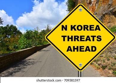 N. Korea threats ahead warning road sign.