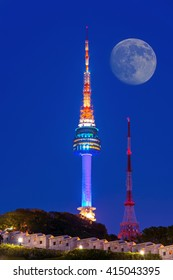N Seoul Tower with full moon Located on Namsan Mountain in central Seoul,South Korea.