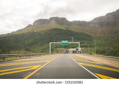 N1 or national road leading towards a tunnel in the mountains or Huguenot Tunnel against the Du Toitskloof mountains in the Cape Winelands area of South Africa